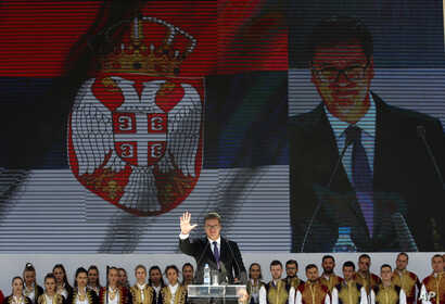 Serbian President Aleksandar Vucic waves to his supporters during a rally in the northern, Serb-dominated part of Mitrovica, Kosovo, Sept. 9, 2018.