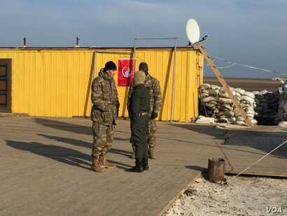 Members of the Noman Chelibijihan Battalion are mostly Tatars but group leaders tell VOA there are also Ukrainians, Chechens, and Afghans. (L. Ramirez/VOA)