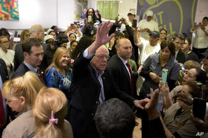 Democratic presidential candidate Sen. Bernie Sanders of Vermont waves to hotel workers at MGM Grand hotel and casino in Las Vegas, Feb. 20, 2016.