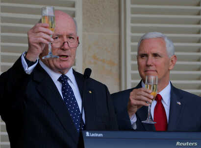 U.S. Vice President Mike Pence (right) and Australian Governor General Peter Cosgrove toast during a lunch reception for Australian and U.S. military servicemen and women at Admiralty House in Sydney, Australia, April 22, 2017.
