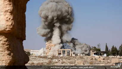 An image distributed by Islamic State militants on social media on August 25, 2015 purports to show the destruction of a Roman-era temple in the ancient Syrian city of Palmyra. Syria's antiquities chief Maamoun Abdulkarim told Reuters the images did ...