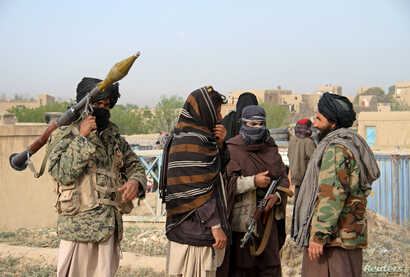 Members of the Taliban gather in Ghazni province, Afghanistan, April 18, 2015. Iran, according to Afghan lawmakers, is supplying sophisticated weapons to the Taliban.