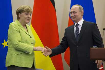 Russian President, Vladimir Putin and German Chancellor Angela Merkel shake hands after their talks in Putin's residence in the Russian Black Sea resort of Sochi, Russia, May 2, 2017.