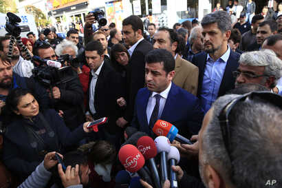 The HDP's Selahattin Demirtas visits Istanbul headquarters of the Koza-Ipek Holding media company, which police seized in a dawn raid on Oct. 28, 2015. The company is linked to opposition television stations and to Fethullah Gulen, a U.S.-based mod...