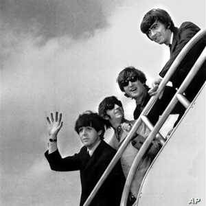 The Beatles, (from left) Paul McCartney, Ringo Starr, John Lennon and George Harrison board a plane for England at a New York airport in 1964.