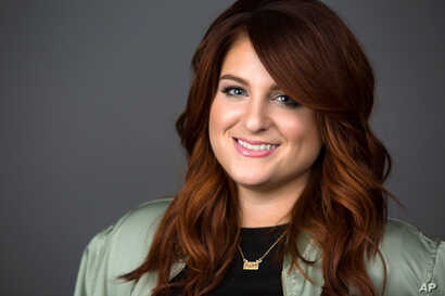 "Singer Meghan Trainor poses for a portrait in New York to promote her new hit single, ""No,"" March 9, 2016."