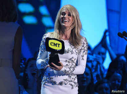 "Carrie Underwood accepts the award for collaborative video of the year for Miranda Lambert's ""Somethin' Bad"" during the 2015 CMT Awards in Nashville, Tennessee, June 10, 2015."
