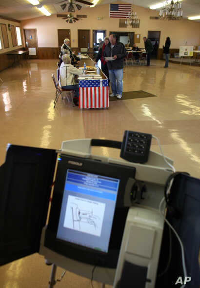 FILE - A voting machine is seen inside a VFW post in Saukville, Wisconsin.