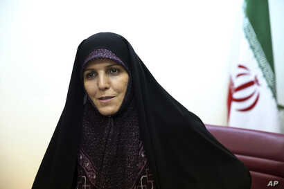 FILE - Then-Vice President for Women and Family Affairs Shahindokht Molaverdi speaks in an interview with The Associated Press at her office in Tehran, Iran, June 8, 2015.