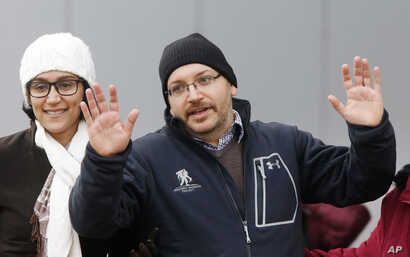 U.S. journalist Jason Rezaian gestures next to his wife Yeganeh Salehi as he poses for media people in front of Landstuhl Regional Medical Center in Landstuhl, Germany, Wednesday, Jan. 20, 2016. Rezaian was released from an Iranian prison last Saturd...