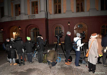 Journalists and press photographers stand outside the Swedish Foreign Ministry, waiting for North Korea's Foreign Minister Ri Yong Ho and his delegation to arrive, in Stockholm, Sweden, March 15, 2018.