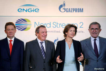 Gazprom chief Alexei Miller, from left, poses with former German Chancellor Gerhard Schroeder, Isabelle Kocher, chief executive officer of French gas and power group Engie, and Gerard Mestrallet, Engie's former chairman & CEO, now non-executive chair...