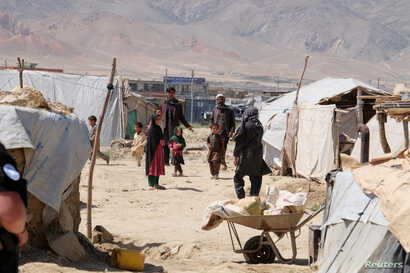 Internally displaced Afghans at a camp outside Kabul, Afghanistan, during a visit by United Nations Secretary General Antonio Guterres June 14, 2017.