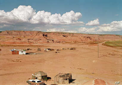 FILE - A remote corner of the Navajo Nation, near Tuba City, Ariz., Aug. 30, 1993. The vastness of rural reservations makes them an ideal location for manufacturing and selling meth, far from the eyes of tribal law enforcement.  (AP Photo/Jeff Robbin...