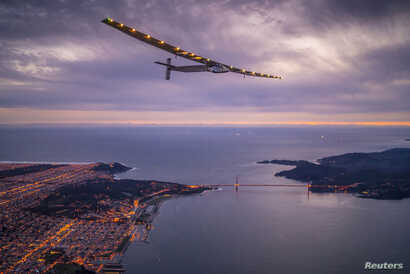 "FILE - ""Solar Impulse 2,"" a solar-powered plane piloted by Bertrand Piccard of Switzerland, flies over the Golden Gate bridge in San Francisco, California, U.S. April 23, 2016, before landing on Moffett Airfield following a 62-hour flight from Hawaii..."