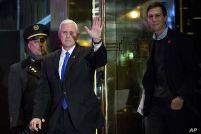 Vice President-elect Mike Pence, second from left, and Jared Kushner, son in-law of President-elect Donald Trump, right, depart Trump Tower, Dec. 7, 2016, in New York.