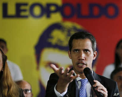 Venezuela's self-proclaimed interim president Juan Guaido, speaks during a news conference at the Voluntad Popular party headquarters in Caracas, Feb. 18, 2019.