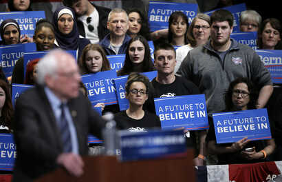Audience members listen as Democratic presidential candidate, Sen. Bernie Sanders, I-Vt., speaks at a campaign rally, in Dearborn, Mich., March 7, 2016.