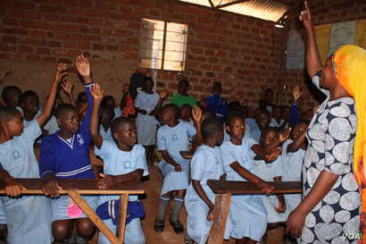 Sarah Sanyu, the headmistress at Parents Care Infant Academy, carries out a menstruation class in the upper primary school in Makindye-Kampala Uganda.