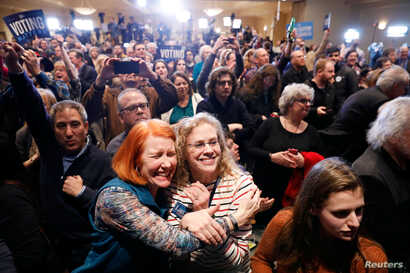 Supporters of U.S. Democratic congressional candidate Conor Lamb react to the results coming in during Lamb's election night rally in Pennsylvania's 18th Congressional District special election against Republican candidate and State Rep. Rick Saccone...