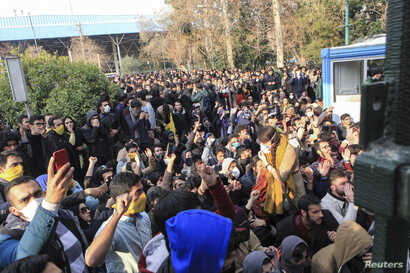 n this photo taken by an individual not employed by the AP, university students attend a protest inside Tehran University, Dec. 30, 2017. A wave of protests over Iran's weak economy swept into Tehran, with college students and others chanting against...
