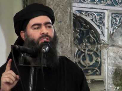 FILE - Image taken a from video shows a man purported to be Abu Bakr al-Baghdadi, senior leader of the Islamic State militant group. It's not clear whether he was hit in a recent airstrike.