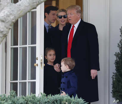 FILE -  President Donald Trump and his family, daughter Ivanka Trump, her husband senior adviser Jared Kushner walks out of the Oval Office of the White House.