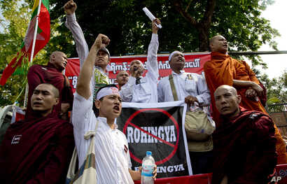 """Members of a Buddhist nationalist group shout slogans during a protest outside U.S. Embassy in Yangon, Myanmar against the embassy's April 20, 2016 statement with the word """"Rohingya"""" Thursday, April 28, 2016."""
