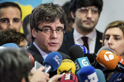 Fugitive Catalan leader Carles Puigdemont addresses the media in Brussels, Belgium, Jan. 24, 2018.