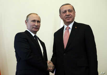 Russian President Vladimir Putin, left, welcomes Turkish President Recep Tayyip Erdogan in the Konstantin palace outside St.Petersburg, Russia, on Aug. 9, 2016.