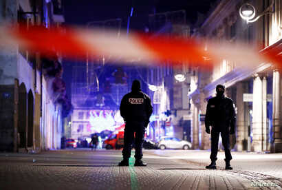 Police secure area where a suspect is sought after a shooting in Strasbourg, France, Dec. 12, 2018.