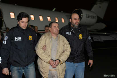 "Mexico's top drug lord Joaquin ""El Chapo"" Guzman is escorted as he arrives at Long Island MacArthur airport in New York, Jan. 19, 2017, following his extradition from Mexico."