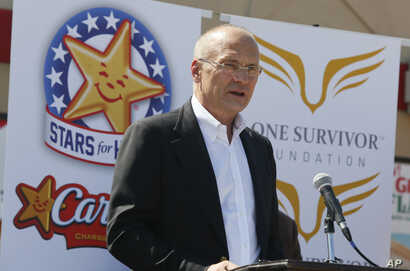 CKE Restaurants CEO Andy Puzder speaks at a news conference on Aug. 6, 2014 in Austin, Texas to highlight Carl's Jr.'s commitment to the state of Texas.