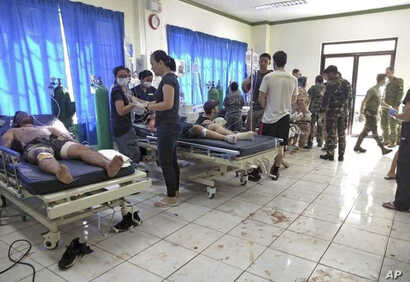 Bomb victims receive treatment in a hospital after two bombs exploded outside a Roman Catholic cathedral in Jolo, the capital of Sulu province in southern Philippines, Jan. 27, 2019, in this photo provided by WESMINCOM Armed Forces of the Philippines...