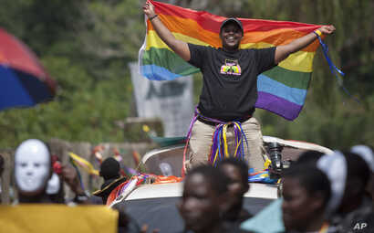 Ugandans take part in the 3rd Annual Lesbian, Gay, Bisexual and Transgender (LGBT) Pride celebrations in Entebbe, Uganda, Aug. 9, 2014.