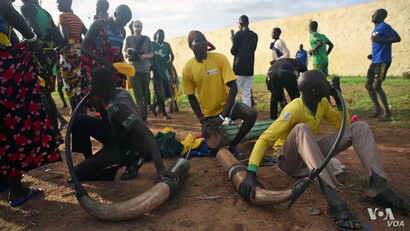 Chanting and singing prep for South Sudan 'wrestling for peace'.