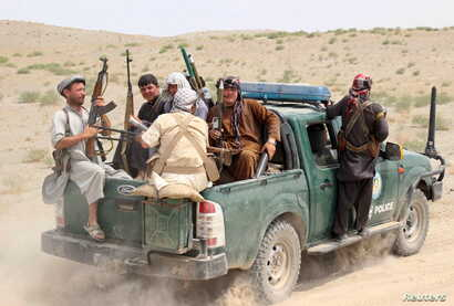 Afghan local police (ALP) sit at the back of a truck near a frontline during a battle with the Taliban, at Qalay-i-zal district, in Kunduz province, Afghanistan, Aug. 1, 2015.