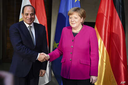 German Chancellor Angela Merkel welcomes Egyptian President Abdel-Fattah el-Sissi for a bilateral meeting during the Munich Security Conference in Munich, Germany, Feb. 16, 2019.