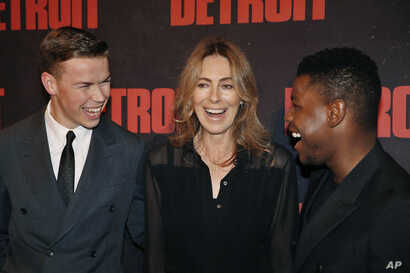 FILE - Actors John Boyega, right, and Will Poulter, left, and director Kathryn Bigelow pose for photographers during the photocall of the film 'Detroit', in Paris, Sept. 29, 2017.
