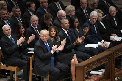 President Donald Trump, first lady Melania Trump, former President Barack Obama, Michelle Obama, former President Bill Clinton, former Secretary of State Hillary Clinton, former President Jimmy Carter, former applaud during a State Funeral for former...
