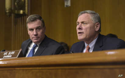 Senate Intelligence Committee Chairman. Sen. Richard Burr, R-N.C., right, joined by Vice Chairman Sen. Mark Warner, D-Va., left, speaks at the Senate Intelligence Committee hearing on Capitol Hill in Washington, March 30, 2017.