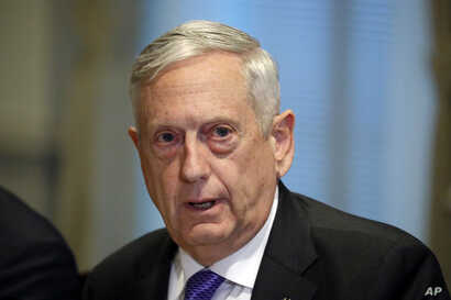 Defense Secretary Jim Mattis answers a question about the ambush of U.S. troops in Niger before a meeting with Israeli Defense Minister Avigdor Lieberman at the Pentagon, Oct. 19, 2017, in Washington.
