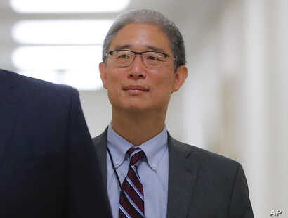 FILE - U.S. Justice Department official Bruce Ohr arrives for a closed hearing of the House Judiciary and House Oversight committees on Capitol Hill in Washington, Aug. 28, 2018.
