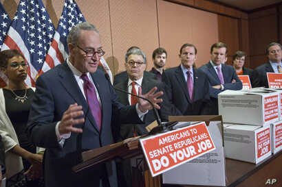 From left, Sen. Charles Schumer, D-N.Y., Sen. Al Franken, D-Minn., Sen. Richard Blumenthal, D-Conn., and Sen. Chris Murphy, D-Conn., talk to reporters on Capitol Hill in Washington about Senate Republicans' refusal to act on any Supreme Court nominat...