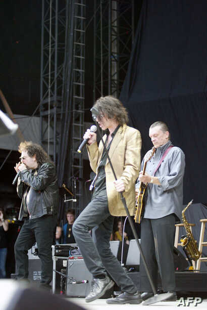 FILE - Magic Dick, Peter Wolf and J. Geils of the J. Geils Band perform at Fenway Park in Boston, Aug. 14, 2010.