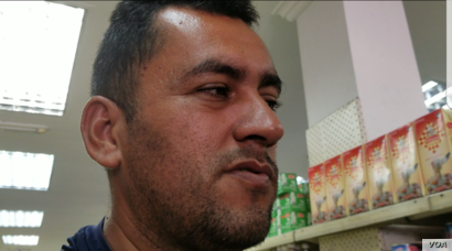 """Pedro Brito, a Venezuelan shopper, claimed he'd sold some belongings to buy food. """"Neither the salary nor the [food bonus] is close to the price of foods. They are not affordable – neither for the middle class nor for those with fewer resources. It..."""