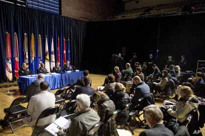 Reporters interview officials on the inaugural preparations being made by the Joint Task Force-National Capital Region for military and civilian planners at the D.C. Armory in Washington, Dec. 14, 2016.