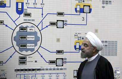 President Hassan Rouhani visits the Bushehr nuclear power plant just outside the port city of Bushehr, Iran, Jan. 13, 2015, in this photo released by the Iranian Presidency Office.