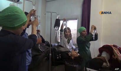 This frame grab from video provided by the Hawar News Agency shows people wounded in an attack by the Islamic State group receiving treatment at a clinic in al-Hasakah province, Syria, May 2, 2017.