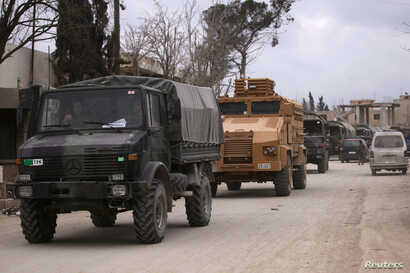 Turkish military vehicles drive in the Syrian rebel-held town of al-Rai, as they head towards the northern Syrian town of al-Bab, Syria March 2, 2017.